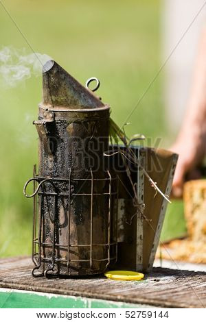Closeup of bee smoker on crate at farm