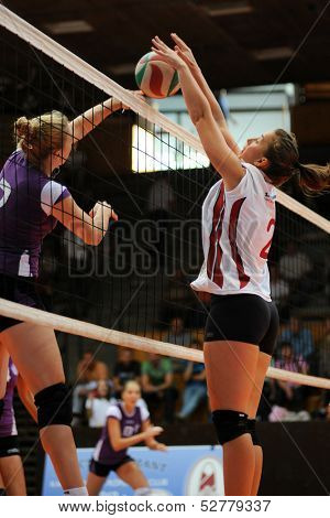 KAPOSVAR, HUNGARY - SEPTEMBER 20: Zsanett Pinter (white 2) in action at the Hungarian I. League volleyball game Kaposvar (white) vs Ujpest (purple), September 20, 2013 in Kaposvar, Hungary.
