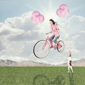 a girl riding her balloon bike in the sky vintage toned poster