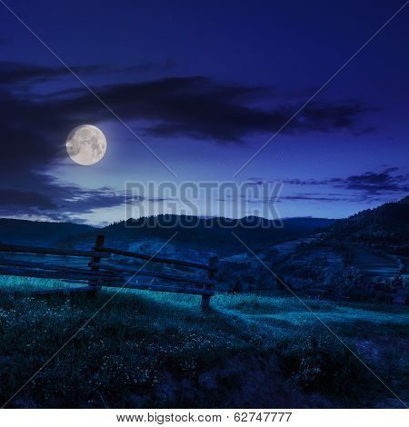 Wooden Fence In The Grass On The Hillside At Night