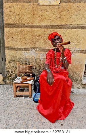 A woman sitting on a bench with a huge cigar