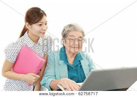 Old woman enjoys computer