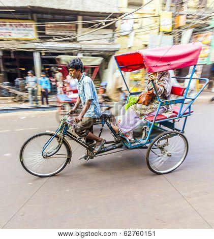 Rickshaw Rider Transports Passenger Early Morning In Delhi