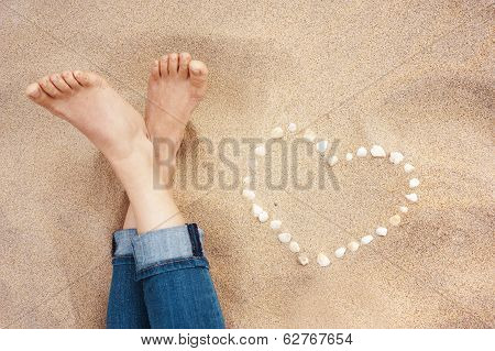Closeup of female feet at the beach