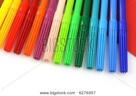 color felt tip pens  on red and white background poster