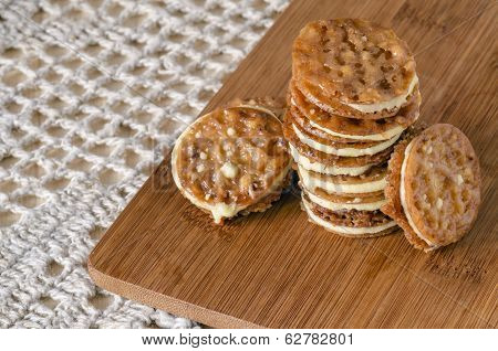 Caramel Florentines Cookies On A Wooden Cutting Board
