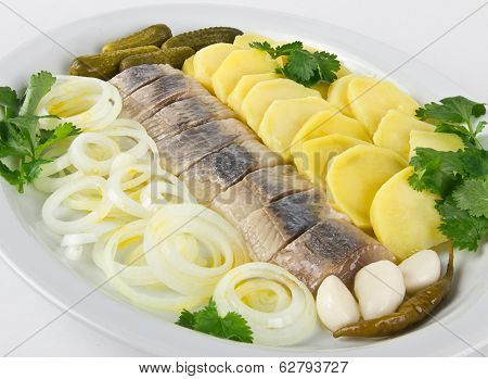 Portion of herring fish fillets with potato and onion poster
