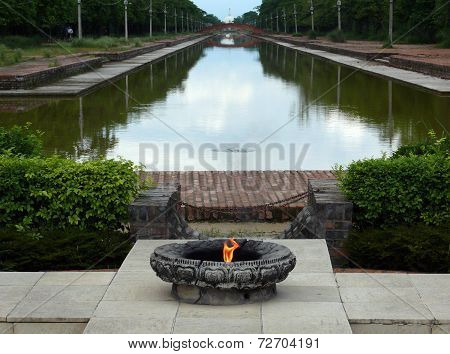 Sacred Flame At The Central Canal Of Lumbini