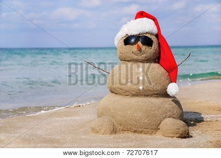 Snowman Made Out Of Sand. Holiday Concept Can For New Year