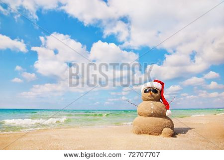Sandy snowman. Holiday concept for New Year's and Christmas Cards