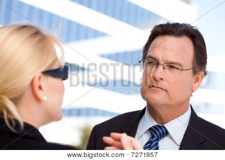 Businessman Listens To Female Colleague