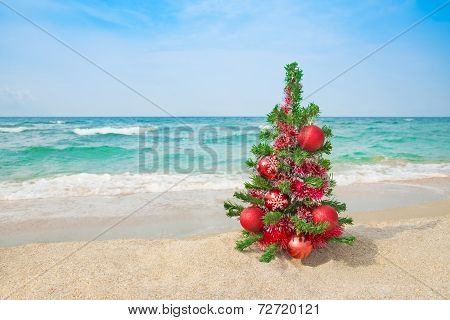 Christmas Tree On The Sea Beach. Christmas Vacation Concept.