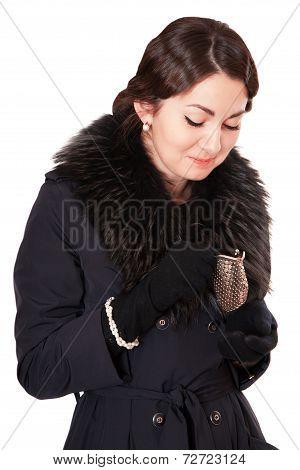 Luxury Woman In A Coat Looks Into An Empty Wallet