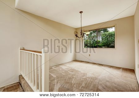 Empty Room In Soft Ivory Tones With Railing