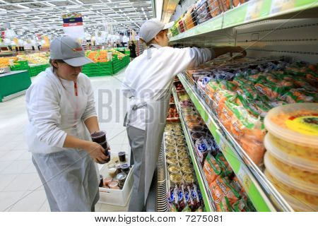 Worker In Supermarket
