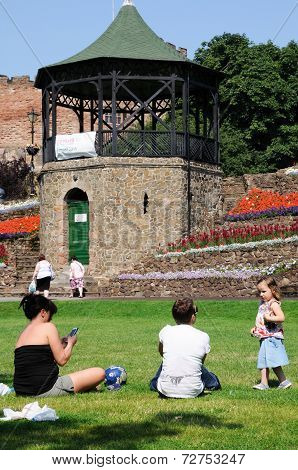 Women with toddler in Tamworth castle gardens.