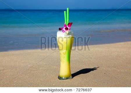 Big Glass Of Cocktail With Two Straws And Flower
