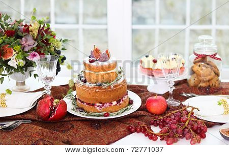 Dessert Table For A Wedding. Cake, Cupcakes, Sweetness And Flowers