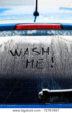 Wash Me Words On A Dirty Car Window