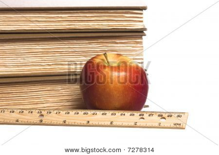 close up apple books ruler