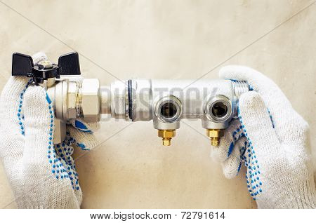 Plumber At Work With Tools Plumbing