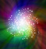 A rotating pattern of dark colors lit up by sparkles swirling round in spiral to a brightly lit sparkly center poster