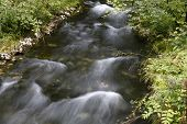 long exposure of water stream in Alps of Germany poster