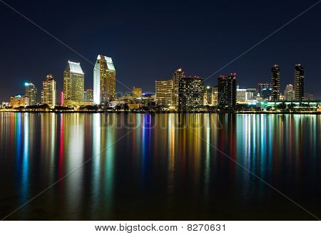 Skyscrapers along the bay in San Diego at night poster