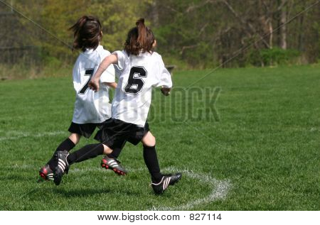 girls youth soccer running
