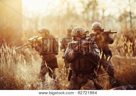 Soldiers With Guns On The Field