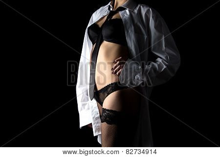 Sexy woman in men's shirt and lingerie