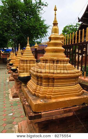 Golden pagoda in row