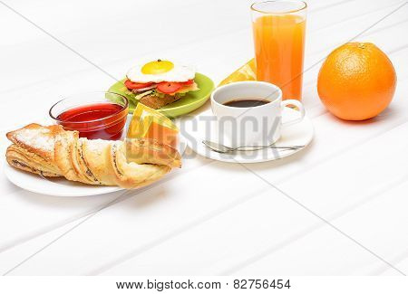 Breakfast with coffee orange juice croissant egg vegetables and fruits poster
