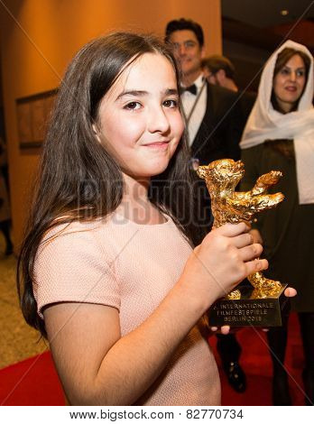 BERLIN, GERMANY - FEBRUARY 14: Solmaz Panahi, Niece of Jafar Panahi with golden bear for 'Taxi'. Closing Ceremony. 65th Berlinale at Berlinale Palace on February 14, 2015 in Berlin, Germany.
