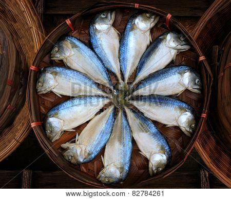thai gulf Mackerel fish boiled cooking ready to eat presale in bamboo tray display for customer in tradition market thailand thai people called this fish is platoo poster