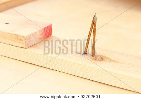 bent nail on wood