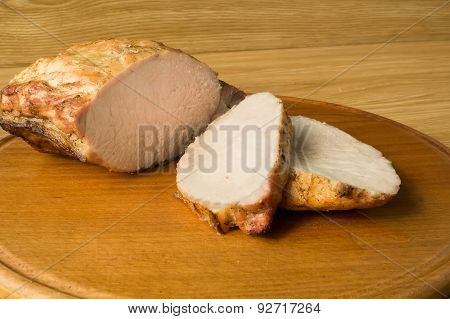 Baked Meat Is Cut For The Portion.