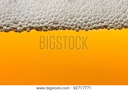 Beer with foam. Macro.