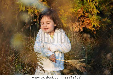 little happy girl basking in the sun
