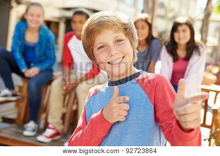 Group Of Children Hanging Out Together In Mall