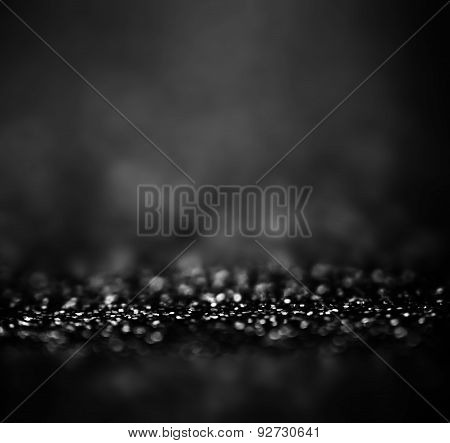 ..black Festive Abstract Background. Christmas Twinkled Bright Background With Bokeh Defocused White