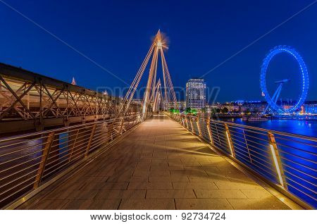 Hungerford Bridge and London Eye during blue hour