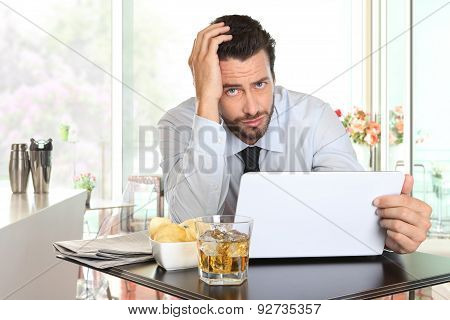 Businessman Worried By The Bad Financial News