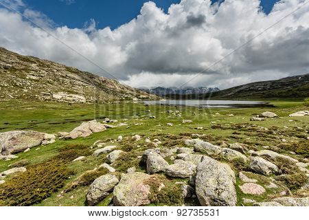 View Across Lac De Nino In Corsica With Mountains In The Background