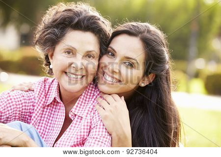 Mother With Adult Daughter In Park Together
