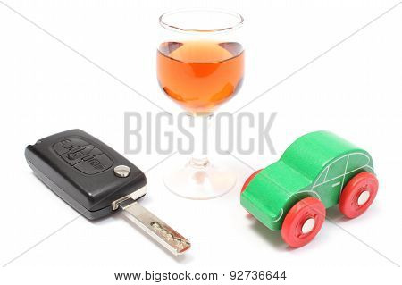 Car Key, Glass Of Wine And Toy Car. White Background