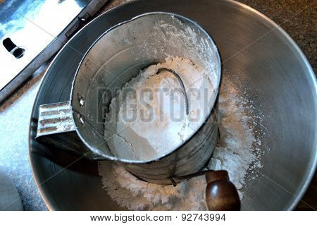 Wooden Handled Antique Sifter With Powdered Sugar In