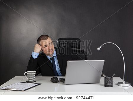 Thinking Businessman In Office.