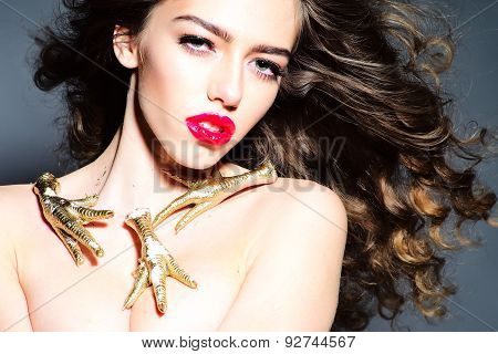 Beauteous Young Undressed Woman With Gold Chicken Feet