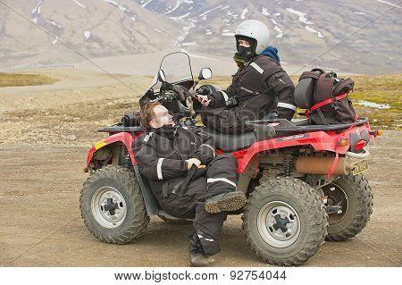 People enjoy off-road vehicle excursion in Longyearbyen, Norway.